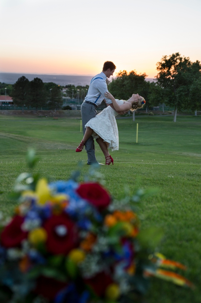 wedding planning design decor inspo real local New Mexico Perfect Wedding Guide couple bright color blue orange red hot air balloon love romantic dancing landscape outdoor detail tea length lace gown styled shoot