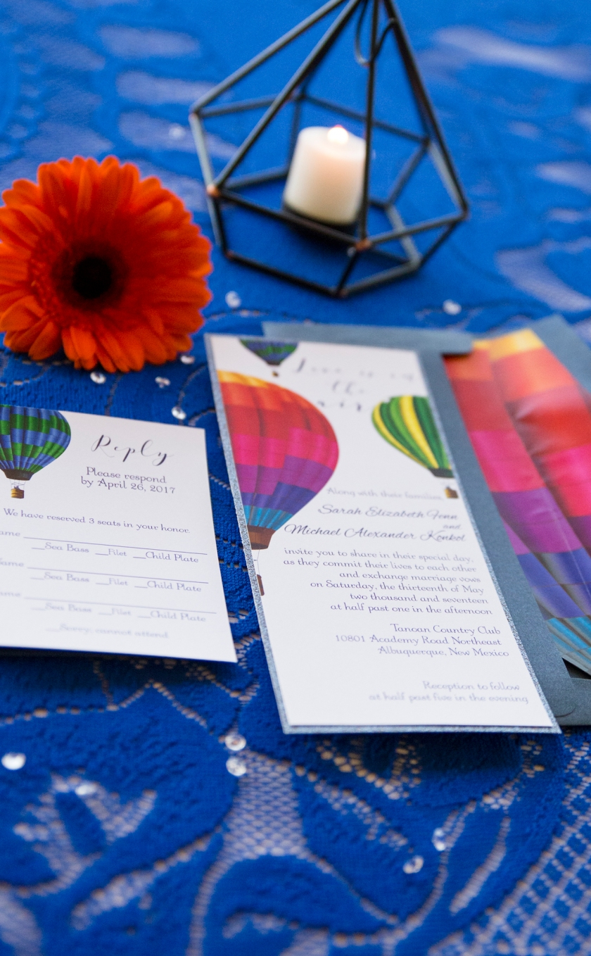 wedding planning design decor inspo real local New Mexico Perfect Wedding Guide couple bright color blue orange red hot air balloon love invitations design tablescape lace sunflower details indoor event ceremony love couple bride