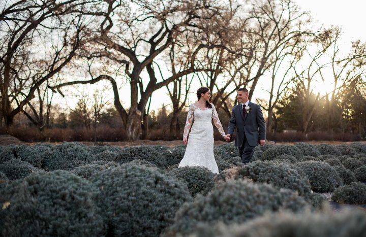 wedding planning design decor inspo real local New Mexico Perfect Wedding Guide outdoor golden hour romantic sleeves lace gown suit nature lavender inspiring bride groom love ceremony reception vows