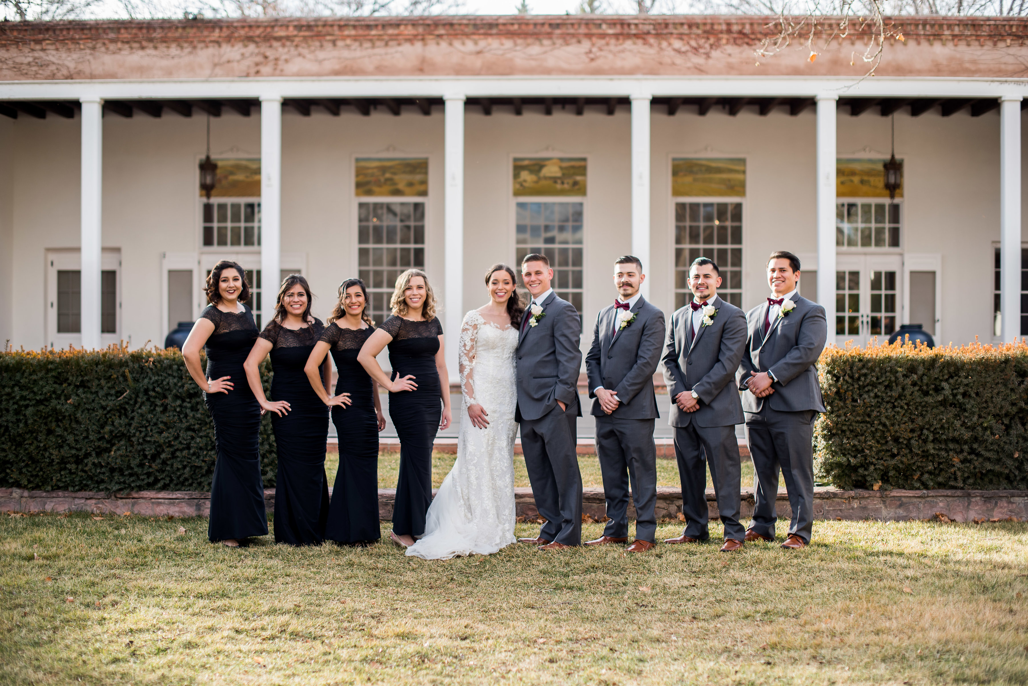wedding planning design decor inspo real local New Mexico Perfect Wedding Guide party bridesmaids groomsmen lace long sleeve group outdoor natural light bride groom love romantic professional