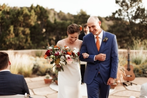 jewel tones wedding outdoor ceremony planning New Mexico design inspiration orange blue suit silk gown bouquet live music band vows officiants real hair bridal photography romantic couple natural light