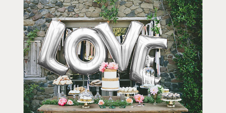 wedding planning design decor unique ceremony reception venue balloons fun love bride groom engagement vows alter tradition married lettering sign desert bar nylon letters photography photo op