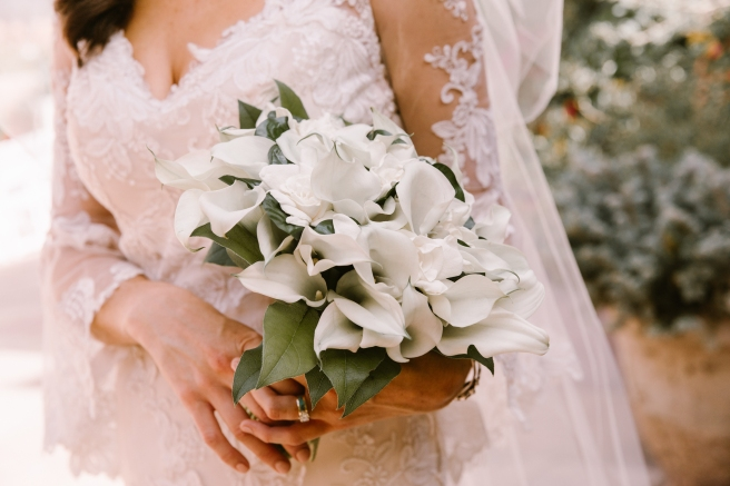 New Mexico wedding Santa Fe planning La Fonda gown suit inspiration design floral bouquet lace photography romantic styled local perfect wedding guide lilies ring sleeves greenery