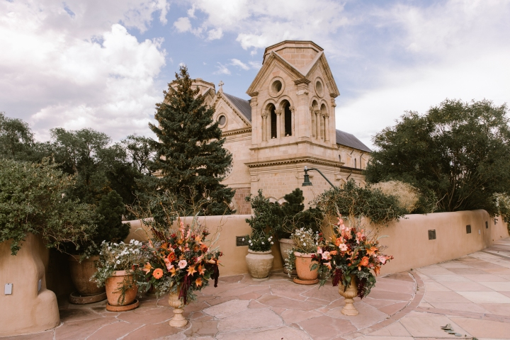 New Mexico wedding Santa Fe planning La Fonda gown suit inspiration design floral bouquet lace photography romantic styled local perfect wedding guide venue architecture historical building cathedral outdoor