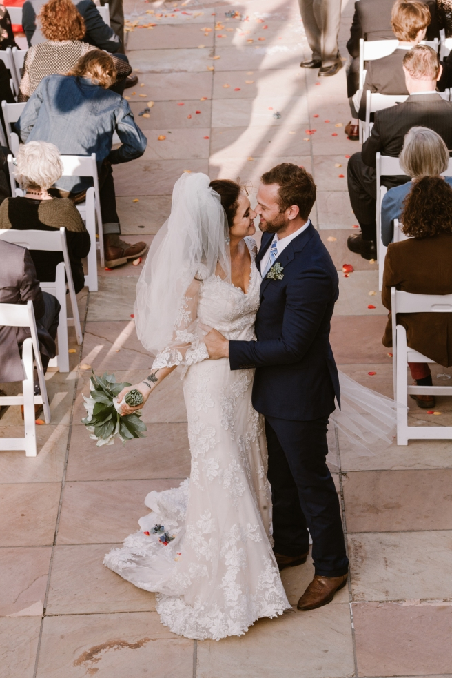 New Mexico wedding Santa Fe planning La Fonda gown suit inspiration design floral bouquet lace photography romantic styled local perfect wedding guide lilies ceremony outdoor greenery natural light Birdseye couple vows flower petals