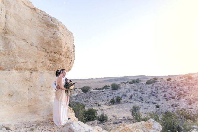 wedding planning photography styled shoot natural light outdoor elopement engagement New Mexico Albuquerque mountains Perfect Wedding Guide landscape unique nature inspiration couple bridal gown gold details bouquet desert Southwestern