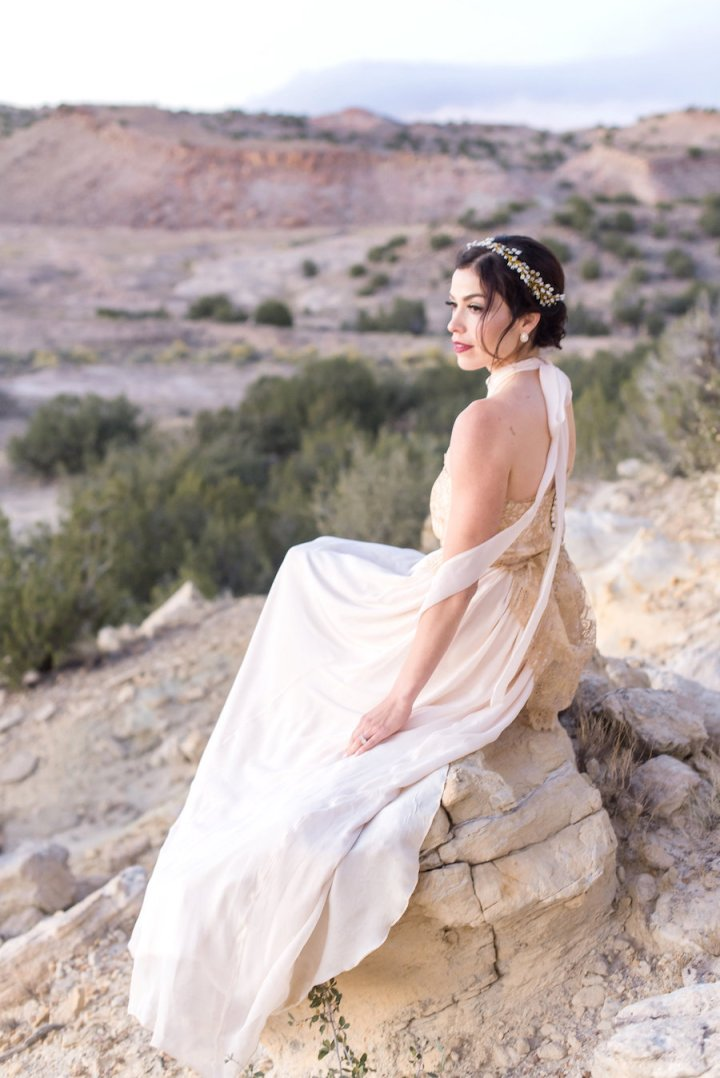 wedding planning photography styled shoot natural light outdoor elopement engagement New Mexico Albuquerque mountains Perfect Wedding Guide gown lace gold dress ribbon high neck hair makeup smoky eye bold lip wedding day hairpiece updo classy elegant love