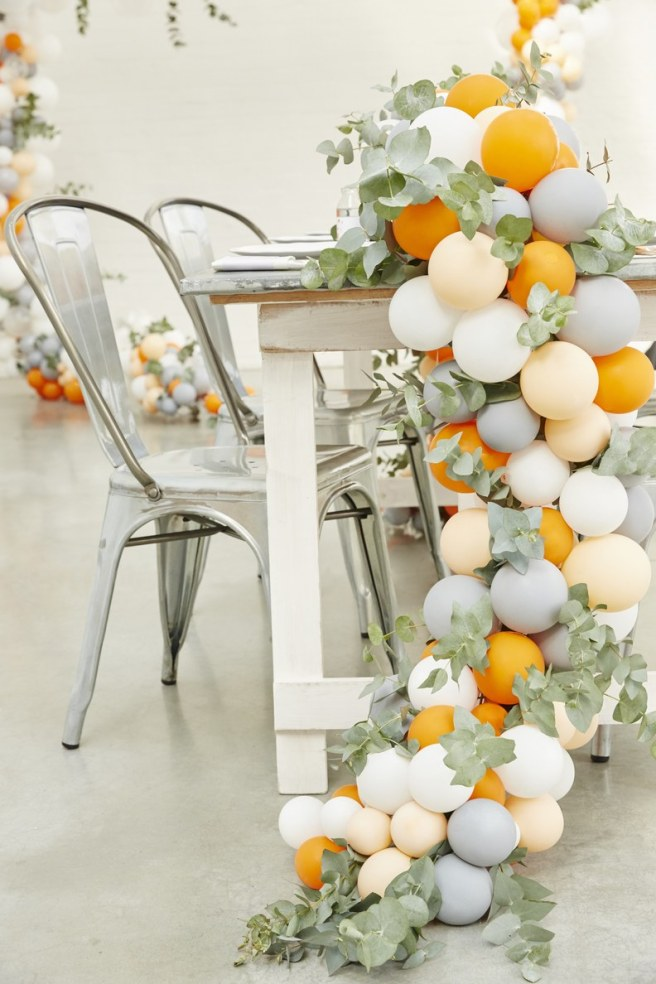 wedding planning design decor unique ceremony reception venue balloons fun love bride groom engagement vows alter tradition married greenery tablescape small balloons reception decor industrial unique vibes