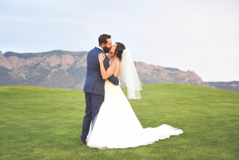 wedding photo picture love romantic kiss sandia event center